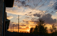 Power Lines Sunset Residential Area In The City