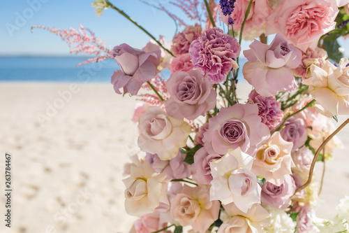 Part Of The Wedding Arch Decorated With Fresh Flowers Is Set