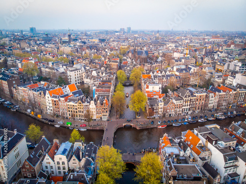 Photo  Aerial view of Amsterdam after sunset, Netherlands