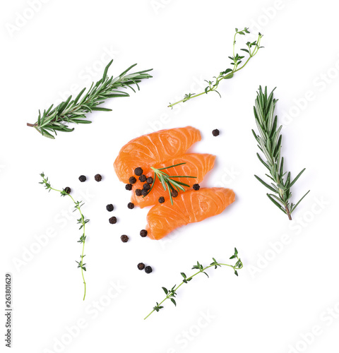 Photo  salmon fillets with spice on white background. top view