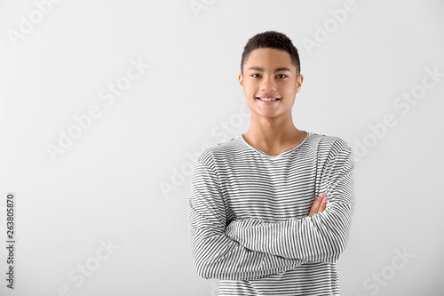 Canvastavla  Portrait of African-American teenage boy on grey background
