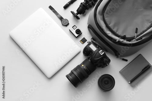 Fototapeta Modern equipment of professional photographer with laptop on light background obraz na płótnie