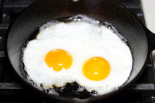 Two Eggs Frying Sunny-side Up ...