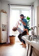 canvas print picture - Small girl with young father in bathroom at home, having fun.