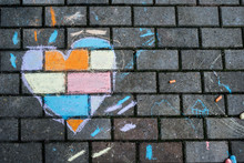 A Heart Shape Drawn With Chalks