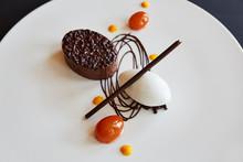 Gourmet Dessert With Chocolate Cake And Kumquats
