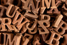 A Pile Of Wooden Letters