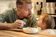 Man With Little Girl Having Meal Time