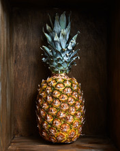 Ripe Juicy Pineapple Fruit In A Wooden Vintage Old Box, Background.