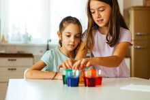 Girls Making And Experiment At Home