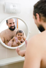 Father And Baby In Bathroom