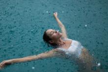 Woman In A Pool Swimming In The Rain