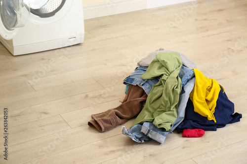 Pile Of Dirty Laundry Near Washing Machine Indoors Space For Text