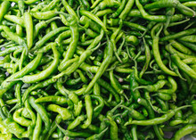 Pile Of Green Chilli Peppers At Farmers Market, New York City