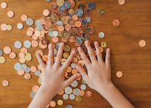 Child's Hands Counting Coins