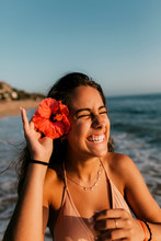 Portrait Of Teen Girl With A Hibiscus Flower
