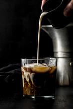 Pouring Milk In Cold Espresso Coffee Glass