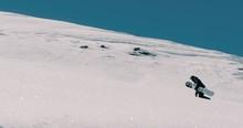 Snowboarder Walking In The Fresh Powder Snow