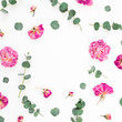 canvas print picture Floral frame of pink flowers and eucalyptus branches on white background. Flat lay, top view.