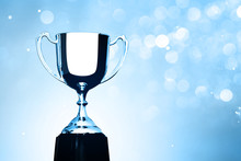 Silver Trophy Competition Award On The Abstract Blurred Light Background With Copy Space, Blue Tone