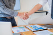 Business people shaking hands in meeting room, Successful deal after meeting.