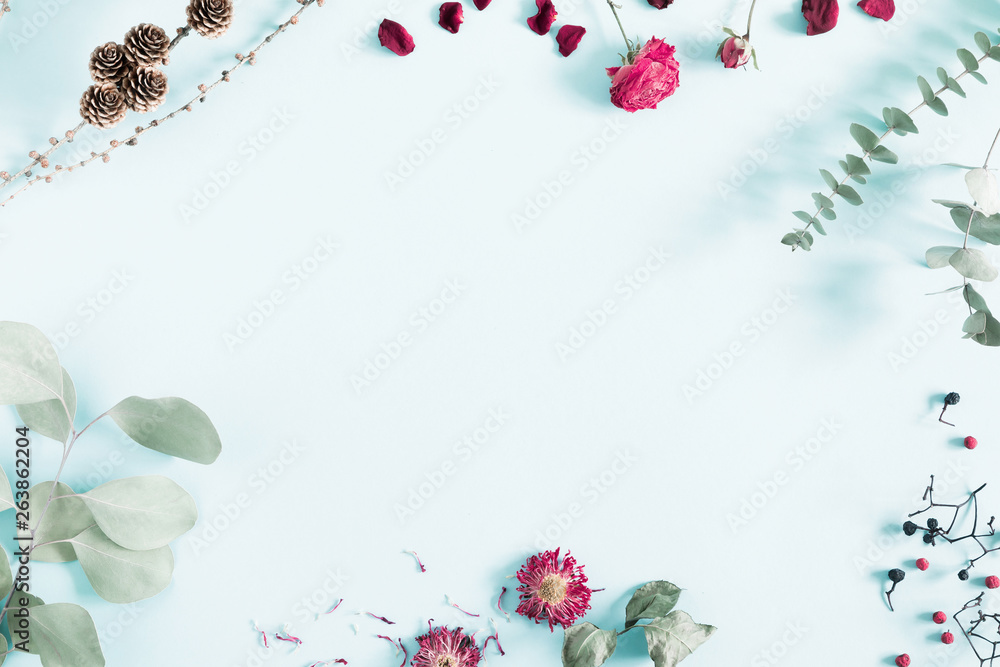 Fototapeta Autumn creative, modern composition. Frame made of berries, eucalyptus leaf, dry roses, petals on white background. Autumn, fall elegant concept. Flat lay, top view, copy space