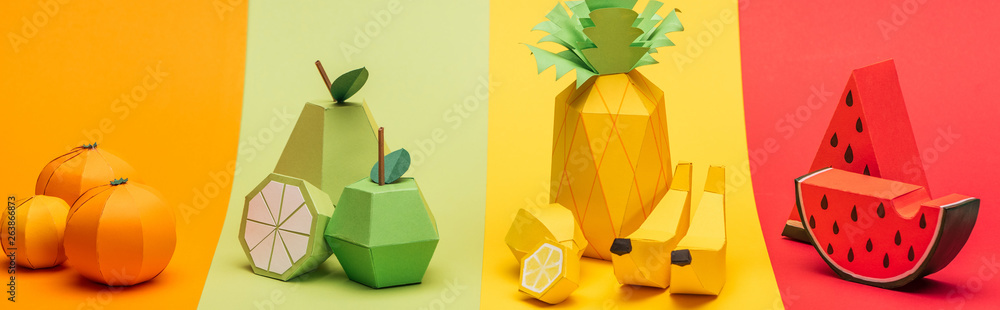 Fototapeta panoramic shot of various handmade origami fruits on stripes of colorful paper
