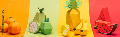 panoramic shot of various handmade origami fruits on stripes of colorful paper Wallpaper Mural