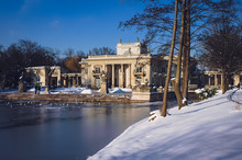 Palace On The Water In Royal Baths Park Or Lazienki Park, Largest Public Park In Warsaw, Capital Of Poland