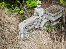 Stone Farmer Statue In Flower ...