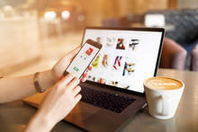 Women Hands Using Smartphone And Laptop Computer For Online Shopping. Payment Detail Page Display.