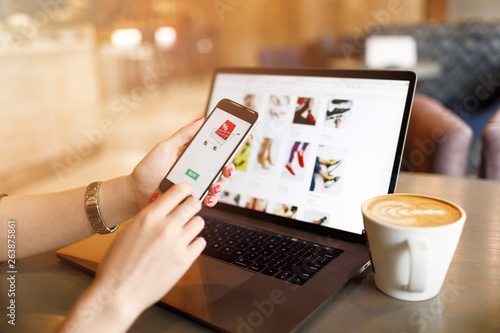 Women hands using smartphone and laptop computer for online shopping Canvas Print