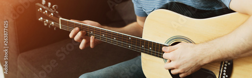 panoramic shot of musician playing acoustic guitar at home - 263877625