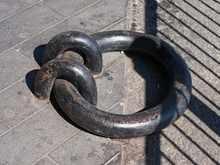 Close-up Of An Old Iron Dock Ring.