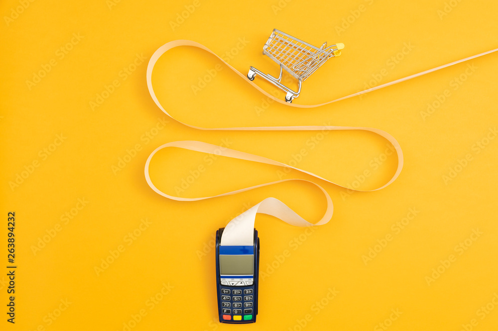 Fototapeta Shopping cart on a long POS terminal receipt
