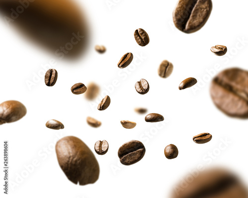 Photo sur Toile Salle de cafe Coffee beans in flight on white background