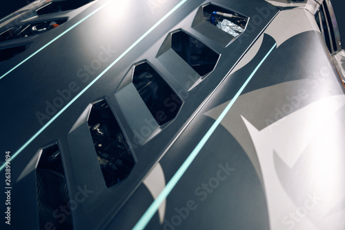 Fotografie, Obraz  Supercar engine hood with air intake and ventilation