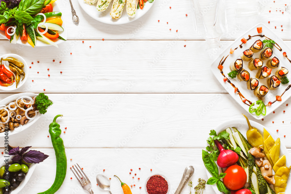 Fototapeta Food buffet selection top view. Party catering meals flat lay. Empty space on white wooden table background.