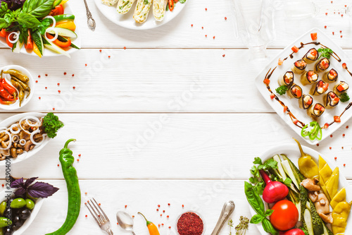 Fototapeta Food buffet selection top view. Party catering meals flat lay. Empty space on white wooden table background. obraz