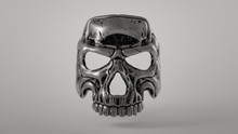 3d Illustration Of A Metal Skull Mask With Tribal Elements Hovering In The Air On A Gray Background. Day Of The Dead. Devil Mask. Mask Of A Human Skull With Scratched Metal. Halloween Background.