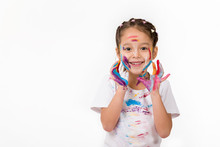 Happy Cute Little Child Girl With Hands Painted In Colorful Paint Isolated On White Background.