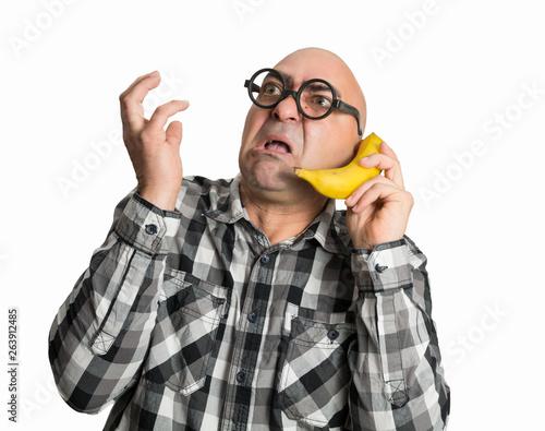 Photo Hablando por teléfono con una banana