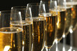 Glasses of champagne on dark background, closeup