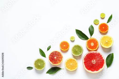Fotografiet Flat lay composition with different citrus fruits on white background