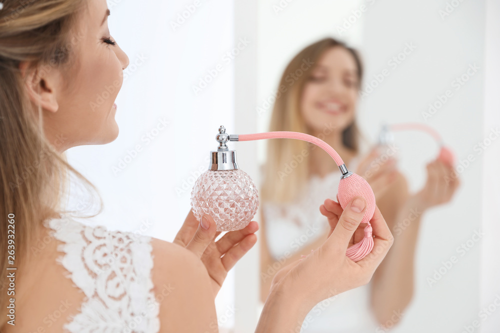 Fototapety, obrazy: Beautiful young bride with bottle of perfume near mirror indoors
