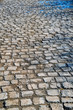 Stone pavement texture. Granite cobble stoned pavement background.