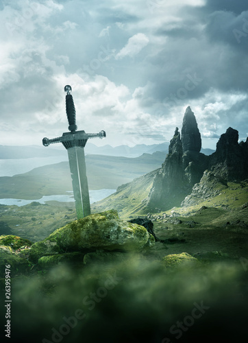 Photo  An aged knights sword stuck in the ground with the rolling mountains from the Isle of Skye in the background