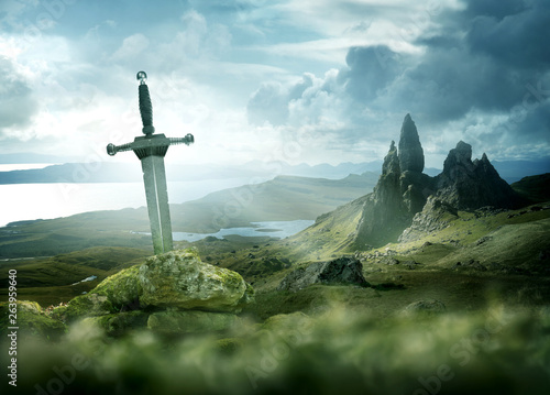 obraz lub plakat An ancient and mythical sword set against a dramatic landscape. Fantasy background 3d mixed media.