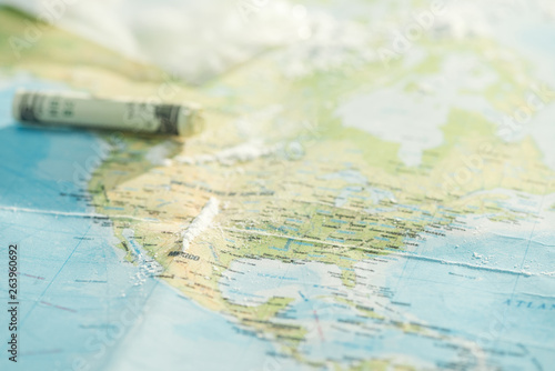 Selective focus of cocaine and dollar banknote on world map Canvas Print