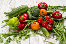 Vegetables Laid Out On The Table, Tomatoes, Cucumbers, Zucchini, Asparagus, Bell Peppers, Parsley, Hot Peppers,